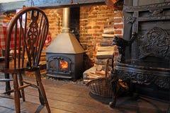 Cosy tudor stove fire burner Royalty Free Stock Photo