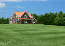 Country house and lawn Stock Images