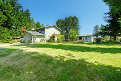 Countryside real estate. Old big house with large front yard Stock Photo