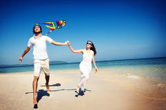 Couple Beach Kite Flying Getaway Holiday Concept Royalty Free Stock Photos