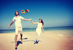 Couple Beach Kite Flying Getaway Holiday Concept Stock Images