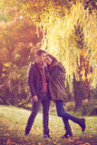 Couple embracing on colorful autumn forest Stock Image