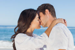 Couple embracing and kissing each other on the beach Royalty Free Stock Photo