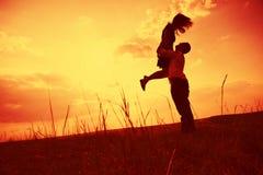 Couple embracing at sunset Royalty Free Stock Photos