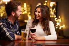 Couple Enjoying Evening Drinks In Bar Stock Image