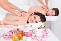 Couple enjoying tissue back massage Royalty Free Stock Image