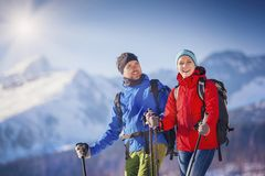 Couple hiking outside in winter nature Stock Images