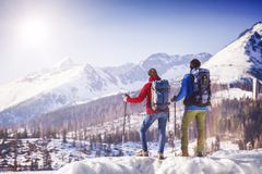Couple hiking outside in winter nature Royalty Free Stock Photo