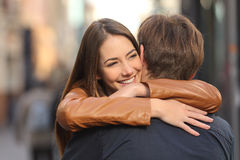 Couple hugging in the street Stock Image