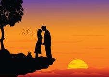 Couple kissing on sunset Stock Image
