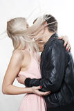 Couple kissing in the wind Stock Images