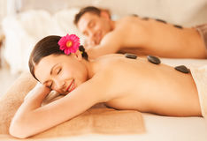 Couple in spa with hot stones Royalty Free Stock Photo