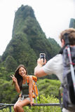 Couple taking photos having fun lifestyle, Hawaii Stock Image