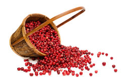 Cranberries spilling from wooden Basket Royalty Free Stock Images