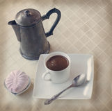 Cup of hot coffee and marshmallow. Toning Stock Photo