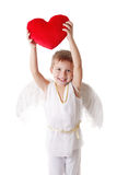 Cupid boy with wings showing red pillow heart Stock Photo