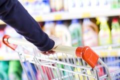 Customer pushing shopping cart Royalty Free Stock Image