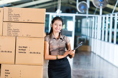 Customer Service in Asian logistics warehouse Royalty Free Stock Image