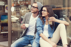 Cute couple outside of cafe Stock Photos