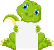 Cute dinosaur cartoon holding blank sign Royalty Free Stock Image