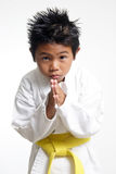 Cute Karate kid bowing Royalty Free Stock Photography