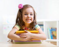 Cute kid girl preschooler with books Royalty Free Stock Images