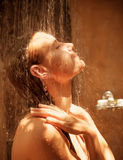 Cute woman take shower Stock Photography