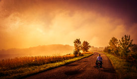 Cycling on the rural roads Royalty Free Stock Images