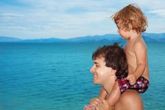 Dad carry kid on shoulders Stock Image