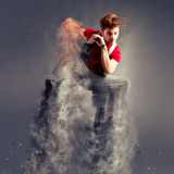 Dancer jumping from explosion Royalty Free Stock Photography
