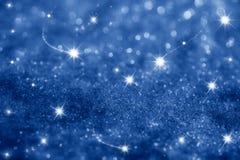Dark blue stars and glitter sparkles background Royalty Free Stock Photo