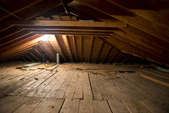 Dark Old Dirty Musty Attic Space in House or Home Royalty Free Stock Photography