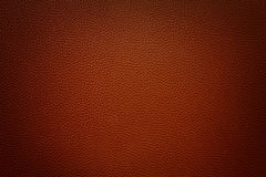 Dark red red synthetic leather  background with vignette Stock Images