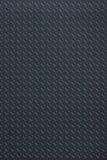 Dark regular plastic texture Stock Photography