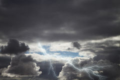 Dark storm rain clouds with lightning Royalty Free Stock Images