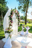 Decorated archway for wedding ceremony with colorful flowers Stock Photography