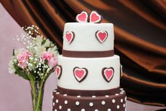 Delicious white and brown wedding cake Stock Images