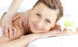 Delighted woman enjoying a back massage Royalty Free Stock Photography