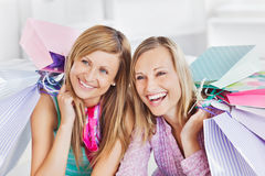 Delighted women holding shopping bags and smiling Royalty Free Stock Photo