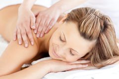 Delighted young woman having a back massage Stock Photography