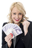 Delighted Young Woman Holding Money Currency Stock Photo