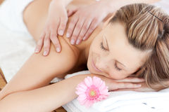 Delighted young woman receiving a back massage Royalty Free Stock Photos