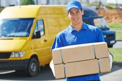 Delivery man with parcel box Stock Images
