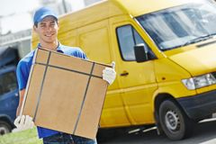 Delivery man with parcel box Royalty Free Stock Image