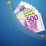 Denimtaschen- und -Eurobanknoten Stockfotos