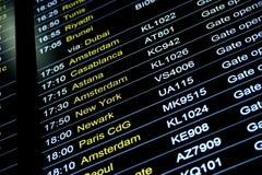 Departures flight information schedule in international airport Stock Photos