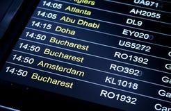 Departures flight information schedule in international airport Stock Photography
