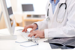 Details of doctor hands typing on keyboard Royalty Free Stock Photo