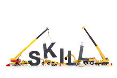Developing skills: Machines building skill-word. Royalty Free Stock Photography