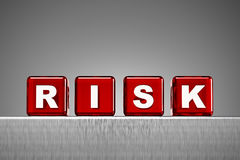 Dice spelling the word risk Royalty Free Stock Image